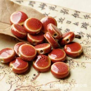 Hạt gốm dẹt tròn 14mm màu đỏ