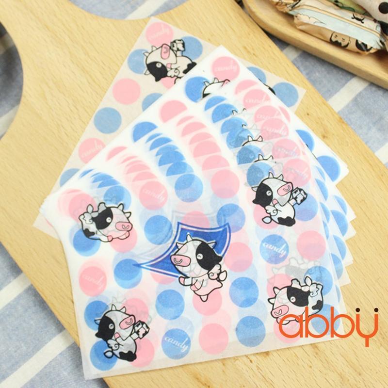 Giấy gói kẹo hình bò sữa xanh hồng 13x9cm (48 - 50 tờ)