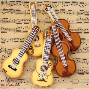 Khuôn nhấn hình đàn ghita