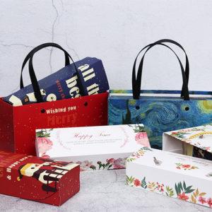 Bộ túi và hộp giấy có quai xách hình người tuyết 21.5x7x5cm